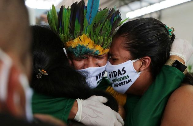 Indigenous people embrace wearing masks with the slogan