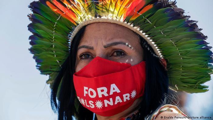 Indigenous woman protests against Bolsonaro in Brasilia, June 2021 (Eraldo Peres/AP)